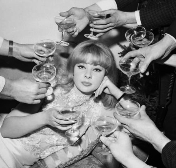 60s-woman-surrounded-by-champagne.jpg